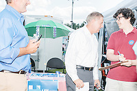 South Carolina Senator and Republican presidential candidate Lindsey Graham speaks with Hillary Clinton campaign worker Gabriel Barnett at the Hillsborough Balloon Festival in Hillsborough, New Hampshire. Graham walked around the festival grounds to introduce himself to New Hampshire voters.