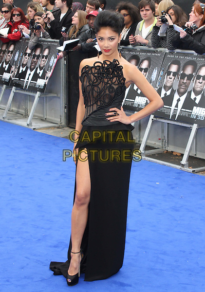 Nicole Scherzinger.The 'Men in Black 3' UK film premiere, Odeon Leicester Square cinema, Leicester Square, London, England..May 16th, 2012.MIB3 III full length black dress lace strapless twisted hand on hip slit split .CAP/ROS.©Steve Ross/Capital Pictures.