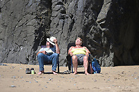 Thursday 25 May 2017<br /> Pictured: A couple relax on the beach in Tenby <br /> Re: People enjoy the warm sunshine in Tenby, , West Wales. Temperatures today are expected to reach the high 20s Centigrade in many parts of the UK, making it one of  warmest days of the year so far