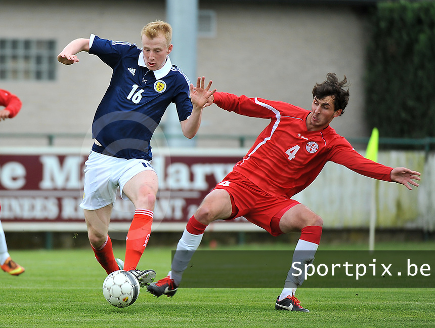 Scotland U19 - Georgia U19 : Mark Beck on the ball before Nika Sandokhadze (4).foto DAVID CATRY / Nikonpro.be
