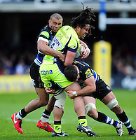 TJ Ioane of Sale Sharks is double-tackled by Jonathan Joseph and Guy Mercer of Bath Rugby. Aviva Premiership match, between Bath Rugby and Sale Sharks on April 23, 2016 at the Recreation Ground in Bath, England. Photo by: Patrick Khachfe / Onside Images