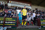 Visiting captain Dougie Gair leading his team out before East Stirlingshire took on Edinburgh City (in yellow) in the second leg of the Scottish League pyramid play-off at Ochilview Park, Stenhousemuir. The play-offs were introduced in 2015 with the winners of the Highland and Lowland Leagues playing-off for the chance to play the club which finished bottom of Scottish League 2. Edinburgh City won the match 1-0 giving them a 2-1 aggregate victory making them the first club in Scottish League history to be promoted into the league.