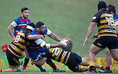 Michael Te'o looks to pass to Christian Kelleher as he is tackled by Tulele Masoe and Chay Mackwood. Counties Manukau Premier 1 McNamara Cup Final between Ardmore Marist and Bombay, played at Navigation Homes Stadium on Saturday July 20th 2019.<br />  Bombay won the McNamara Cup for the 5th time in 6 years, 33 - 18 after leading 14 - 10 at halftime.<br /> Photo by Richard Spranger.