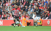 Southampton's Nathan Redmond under pressure from Burnley's Jack Cork<br /> <br /> Photographer Kevin Barnes/CameraSport<br /> <br /> The Premier League - Southampton v Burnley - Sunday August 12th 2018 - St Mary's Stadium - Southampton<br /> <br /> World Copyright &copy; 2018 CameraSport. All rights reserved. 43 Linden Ave. Countesthorpe. Leicester. England. LE8 5PG - Tel: +44 (0) 116 277 4147 - admin@camerasport.com - www.camerasport.com