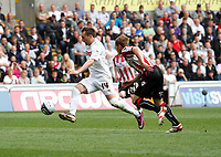 Npower Championship, Swansea City FC (white) V Sheffield United. Sat 7th May 2011 (12.45pm KO)<br /> Pictured: Stephen Dobbie of Swansea shakes of Rob Kozluk to break free inside the box<br /> Picture by: Ben Wyeth / Athena Picture Agency<br /> info@athena-pictures.com<br /> 07815 441513
