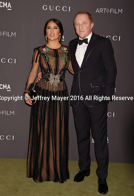 LOS ANGELES, CA - OCTOBER 29: Actress Salma Hayek (L) and husband/businessman Francois-Henri Pinault attend the 2016 LACMA Art + Film Gala honoring Robert Irwin and Kathryn Bigelow presented by Gucci at LACMA on October 29, 2016 in Los Angeles, California.