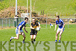 Shane Myers Crokes goes past Shane Daly Laune Rangers in Killorglin on Sunday