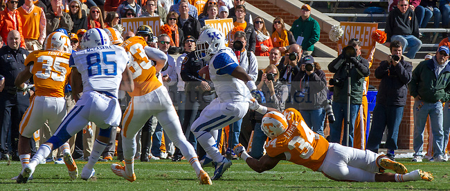 Wildcat junior tailback Raymond Sanders III manages to make Tennessee's Herman Lathers miss a tackle as he turns the ball upfield in Knoxville, Tn., on Saturday, November, 24, 2012. Photo by James Holt | Staff