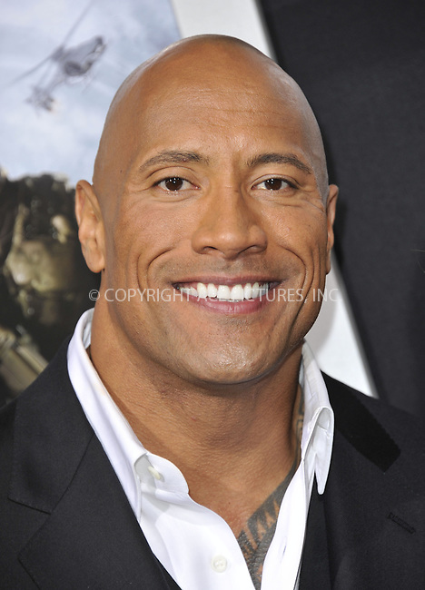 WWW.ACEPIXS.COM....March 28 2013, LA....Dwayne Johnson (The Rock) arriving at the 'G.I. Joe: Retaliation' Los Angeles premiere at the TCL Chinese Theatre on March 28, 2013 in Hollywood, California.......By Line: Peter West/ACE Pictures......ACE Pictures, Inc...tel: 646 769 0430..Email: info@acepixs.com..www.acepixs.com