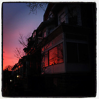 The morning glow reflects in a window on Cherokee Street in the Germantown section of Philadelphia, January 25, 2013.