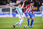 Jonathan Castro Otto, Jonny, (l) of RC Celta de Vigo battles for the ball with Angel Correa of Atletico de Madrid during their La Liga match between Atletico de Madrid and RC Celta de Vigo at the Vicente Calderón Stadium on 12 February 2017 in Madrid, Spain. Photo by Diego Gonzalez Souto / Power Sport Images