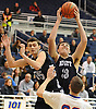 Zach Bromfeld #33 of Hewlett, right, secures a rebound near teammate Troy Feeney #35 during the Nassau County varsity boys basketball Class A semifinals aginst South Side at Hofstra University on Wednesday, Feb. 24, 2016. Hewlett went to halftime leading 23-20.