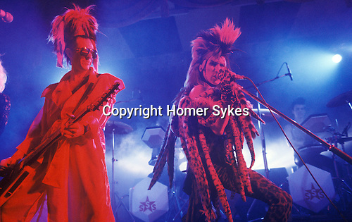 Sigue Sigue Sputnik 1980s New Wave band. Tony  James ( in red ) and Martin Degville vocals. Newcastle upon Tyne. UK