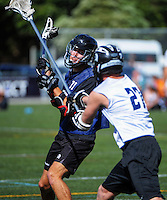 Action from the final between Auckland White and Auckland Blue during the National Lacrosse Tournament at Wakefield Park, Wellington, New Zealand on Sunday, 29 March 2015. Photo: Dave Lintott / lintottphoto.co.nz