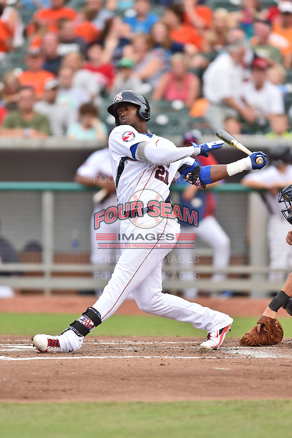 Tennessee Smokies right fielder Jorge Soler #21 swings at a pitch during a game against the Mississippi Braves at Smokies Park on July 21, 2014 in Kodak, Tennessee. The Braves defeated the Smokies 4-3. (Tony Farlow/Four Seam Images)