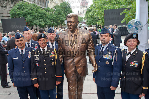 US Army and Air Force soldiers pose for photographers after the inauguration of the new statue of Ronald Reagan (C) on the square named Freedom in Budapest, Hungary. Wednesday, 29. June 2011. ATTILA VOLGYI