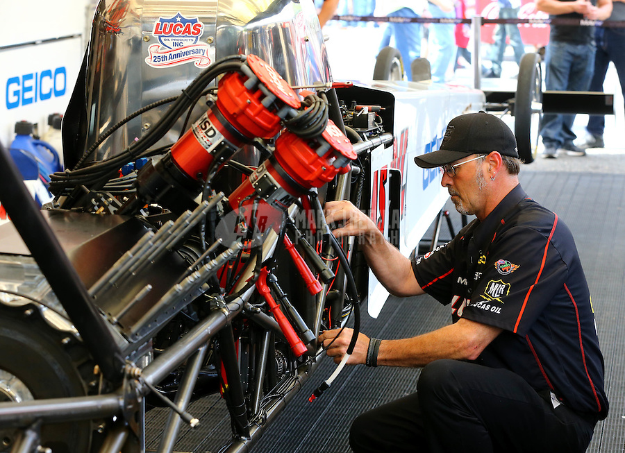 May 30, 2014; Englishtown, NJ, USA; Crew member for  NHRA top fuel driver Morgan Lucas during qualifying for the Summernationals at Raceway Park. Mandatory Credit: Mark J. Rebilas-