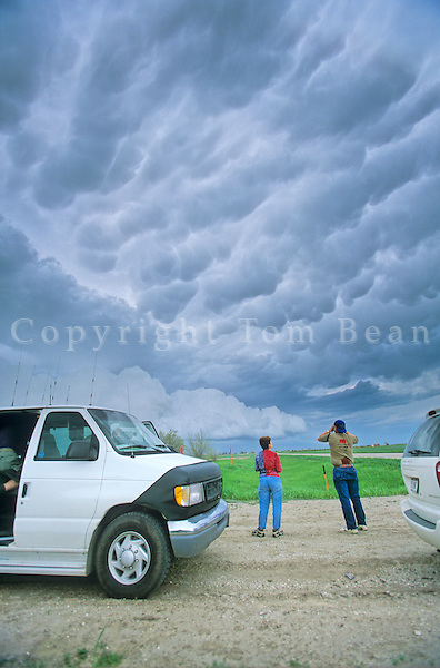Storm chasers viewing stormy sky in Tornado Alley region of Great Plains, near Alliance, Nebraska, AGPix_0343.