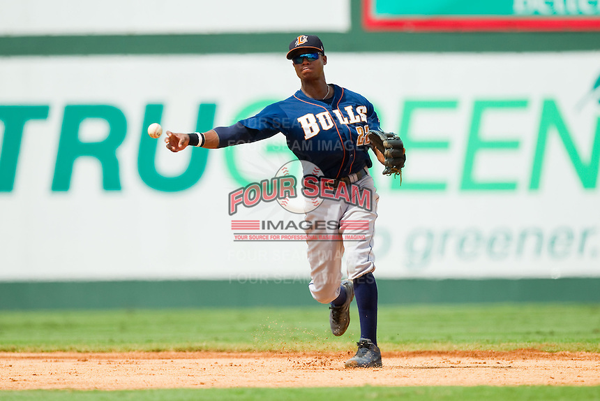Durham Bulls shortstop Tim Beckham (22) makes a throw to first base against the Charlotte Knights at Knights Stadium on August 18, 2013 in Fort Mill, South Carolina.  The Bulls defeated the Knights 8-5 in Game One of a double-header.  (Brian Westerholt/Four Seam Images)