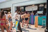 Beachgoers buy food and snacks at concessions at Rockaway Beach in the Queens borough of New York on Sunday, July 19, 2015.  The temperature climbed to 93 F with Monday expected to hit 92 F making them the first and second over 90 days of the year. If Tuesday hits 90 the city will have its first heat wave of the year. (© Richard B. Levine)