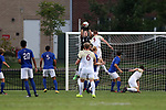 ELON, NC - SEPTEMBER 02: Presbyterian's Connor Behrend (in black) grabs the ball under pressure from Elon's Luke Matthews (5). The Elon University Phoenix hosted the Presbyterian College Blue Hose on September 2, 2017 at Rudd Field in Elon, NC in a Division I college soccer game. Elon won the game 2-0.