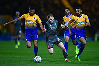 Lincoln City's Harry Anderson gets between Mansfield Town's Malvind Benning, left, and CJ Hamilton<br /> <br /> Photographer Andrew Vaughan/CameraSport<br /> <br /> The EFL Sky Bet League Two - Mansfield Town v Lincoln City - Monday 18th March 2019 - Field Mill - Mansfield<br /> <br /> World Copyright © 2019 CameraSport. All rights reserved. 43 Linden Ave. Countesthorpe. Leicester. England. LE8 5PG - Tel: +44 (0) 116 277 4147 - admin@camerasport.com - www.camerasport.com