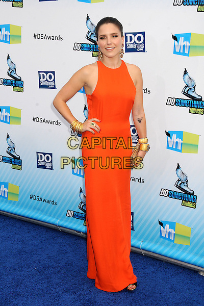 Sophia Bush.The 2012 Do Something Awards at the Barker Hangar in Santa Monica, California, USA..August 19th, 2012.full length dress sleeveless orange clutch bag gold bracelets hand on hip.CAP/ADM/BP.©Byron Purvis/AdMedia/Capital Pictures.