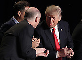 United States President Donald Trump talks with television producer Mark Burnett (C) and Rep. Robert Aderholt (L) (R-AL) at the National Prayer Breakfast February 2, 2017 in Washington, DC. Every U.S. president since Dwight Eisenhower has addressed the annual event.  <br /> Credit: Win McNamee / Pool via CNP
