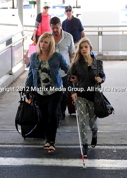 4 DECEMBER 2012 SYDNEY AUSTRALIA ..EXCLUSIVE ..Rachael Leahcar pictured at Sydney Domestic Airport with her parents. ....*No internet without clearance*.MUST CALL PRIOR TO USE ..+61 2 9211-1088.Matrix Media Group.Note: All editorial images subject to the following: For editorial use only. Additional clearance required for commercial, wireless, internet or promotional use.Images may not be altered or modified. Matrix Media Group makes no representations or warranties regarding names, trademarks or logos appearing in the images.4 DECEMBER 2012 SYDNEY AUSTRALIA ..EXCLUSIVE ..Rachael Leahcar pictured at Sydney Domestic Airport with her parents. ....*No internet without clearance*.MUST CALL PRIOR TO USE ..+61 2 9211-1088.Matrix Media Group.Note: All editorial images subject to the following: For editorial use only. Additional clearance required for commercial, wireless, internet or promotional use.Images may not be altered or modified. Matrix Media Group makes no representations or warranties regarding names, trademarks or logos appearing in the images.