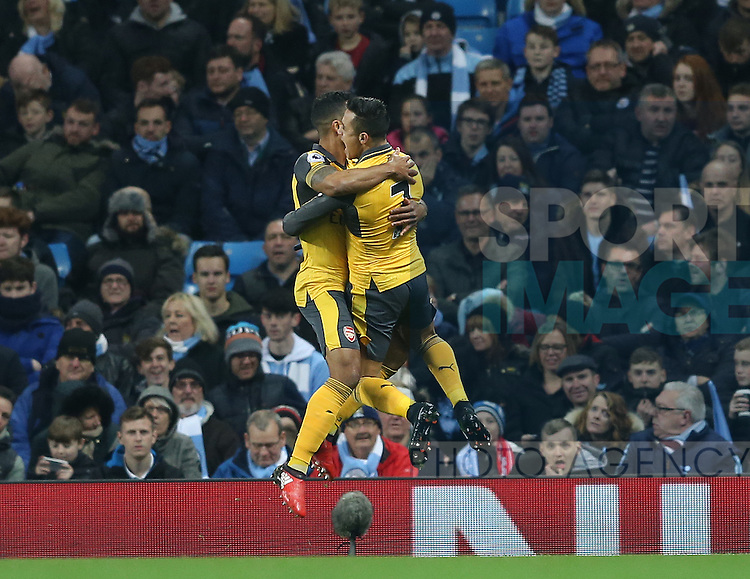 Theo Walcott of Arsenal (l) celebrates the opening goal with Alexis Sanchez of Arsenal during the English Premier League match at the Etihad Stadium, Manchester. Picture date: December 18th, 2016. Picture credit should read: Simon Bellis/Sportimage