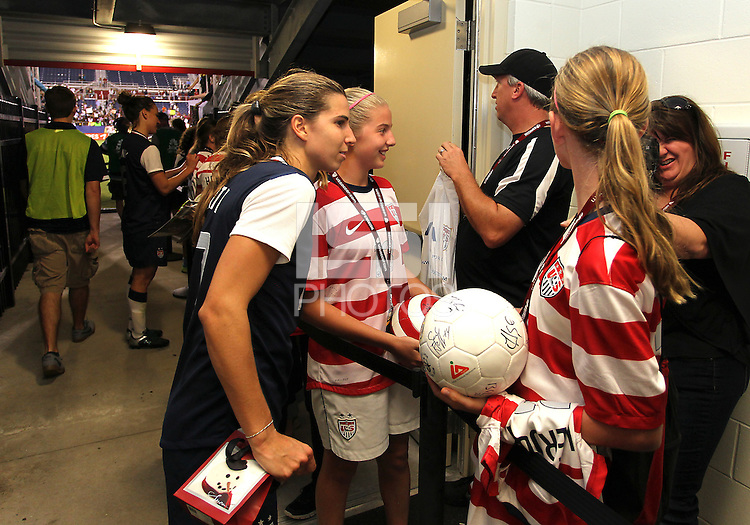 BOCA RATON, FL - DECEMBER 15, 2012: Tobinn Heath (17) of the USA WNT signs autographs at the end of an international friendly match against China  at FAU Stadium, in Boca Raton, Florida, on Saturday, December 15, 2012. USA won 4-1.