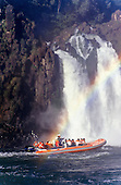 Iguassu Falls, Parana State, Brazil.  People on boat at the foot of the waterfalls.