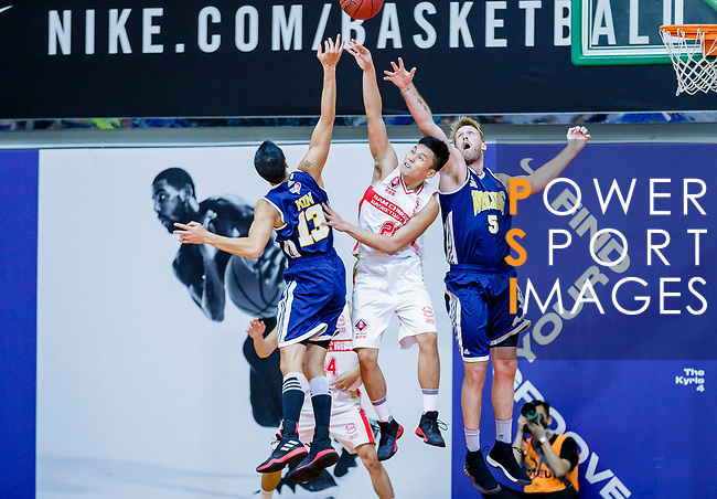 Wong Tsz Him #21of Nam Ching Basketball Team (C) vies with Joe Glen Matthew #13 of Winling Basketball Club (L) and Bullen Christian Matthew #4 of Winling Basketball Club (R) during the Hong Kong Basketball League game between Nam Ching vs Winling at Southorn Stadium on May 11, 2018 in Hong Kong. Photo by Yu Chun Christopher Wong / Power Sport Images