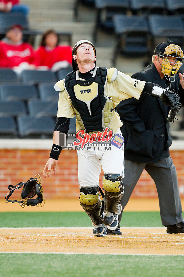 Wake Forest Demon Deacons catcher Brett Armour (6) tracks a pop fly during the game against the North Carolina State Wolfpack at Wake Forest Baseball Park on March 15, 2013 in Winston-Salem, North Carolina.  The Wolfpack defeated the Demon Deacons 12-6.  (Brian Westerholt/Sports On Film)