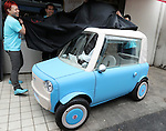 "May 20, 2016, Tokyo, Japan - Japanese car designer Kota Nezu displays the prototype model of the electric powered personal mobility ""rimOnO"" in Tokyo on Friday, May 20, 2016. The rimOnO, 2m in length and 1m wideth, is equipped with in-wheel motors to drive two seater light weight body which is made by soft materials.  (Photo by Yoshio Tsunoda/AFLO) LWX -ytd-"