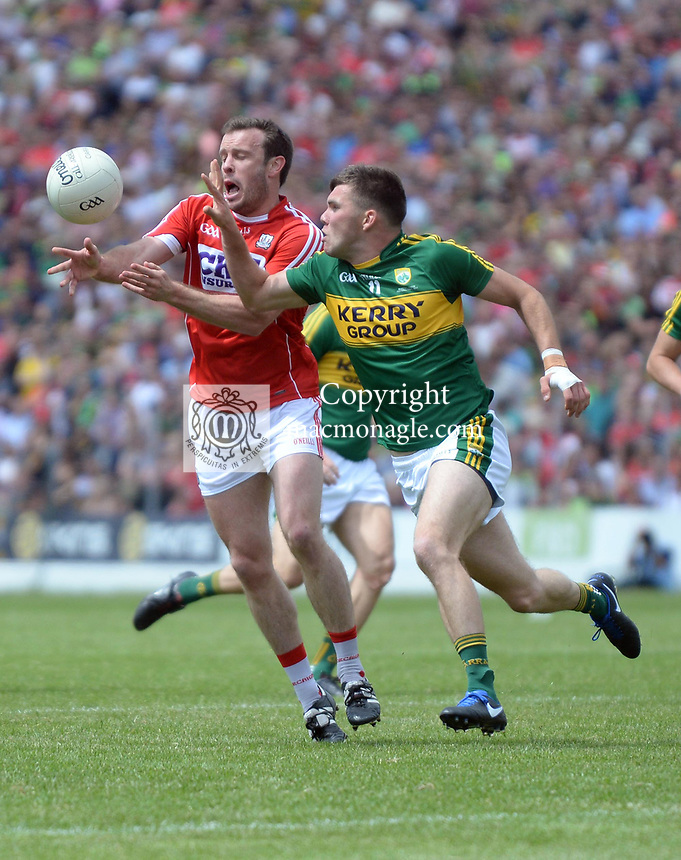 2-7-2017: Cork's James Loughrey and Kerry's Kevin Mccarthy in action  at the Kerry V Cork Munster Football final in Killarney on Sunday.<br /> Photo: Don MacMonagle