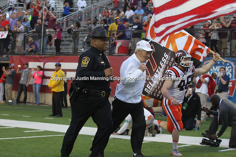 December 26, 2015: Virginia Tech head football coach Frank Beamer leading his team onto the field of the Camping World Independence Bowl at Independence Stadium in Shreveport, LA. Justin Manning/ESW/CSM