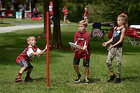 NWA Democrat-Gazette/BEN GOFF @NWABENGOFF<br /> Jackson Hill (from left), 7, Mitchell York, 9, and Lacey Gartside, 10, all of Fayetteville, play games on Saturday Sept. 19, 2015 while tailgating before the Arkansas football game against Texas Tech in Fayetteville.