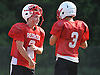 East Islip quarterback No. 2 Jack Hannigan stays hydrated as he chats with a teammate during football practice at the high school on Wednesday, August 19, 2015.