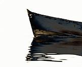 PANAMA, boat reflecting in Caribbean Sea, Bocas del Toro (B&W)