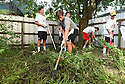 Tulane freshmen Jonathan Star, Chase Schupp and Sam Wetzel clean up a backyard while volunteering with South Seventh Ward Neighbors, 2016.