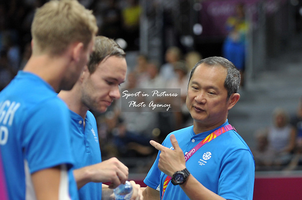 Coach Tat Meng Wong (SCO) speaks to Martin CAMPBELL (SOC) and Patrick MACHUGH (SOC) in the mens doubles. Badminton. Mixed team event. XXI Commonwealth games. Carrara Sports hall 2. Gold Coast 2018. Queensland. Australia. 05/04/2018. ~ MANDATORY CREDIT Garry Bowden/SIPPA - NO UNAUTHORISED USE - +44 7837 394578