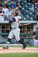 Tyler Collins (18) of the Toledo Mud Hens follows through on his swing against the Charlotte Knights at BB&T BallPark on April 27, 2015 in Charlotte, North Carolina.  The Knights defeated the Mud Hens 7-6 in 10 innings.   (Brian Westerholt/Four Seam Images)
