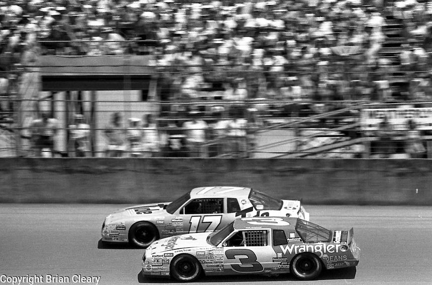 Dale Earnhardt Darrell Waltrip action Pepsi Firecracker 400 Daytona International Speedway Daytona Beach FL July 1987 (Photo by Brian Cleary/www.bcpix.com)