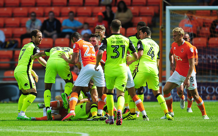 Players from both sides rush in after Exeter City's Craig Woodman is fouled by Blackpool's Danny Pugh<br /> <br /> Photographer Kevin Barnes/CameraSport<br /> <br /> Football - The EFL Sky Bet League Two - Blackpool v Exeter City - Saturday 6th August 2016 - Bloomfield Road - Blackpool<br /> <br /> World Copyright &copy; 2016 CameraSport. All rights reserved. 43 Linden Ave. Countesthorpe. Leicester. England. LE8 5PG - Tel: +44 (0) 116 277 4147 - admin@camerasport.com - www.camerasport.com