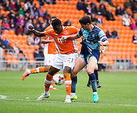 Joe Jacobson of Wycombe Wanderers battles with Bright Osayi-Samuel of Blackpool during the Sky Bet League 2 match between Blackpool and Wycombe Wanderers at Bloomfield Road, Blackpool, England on 20 August 2016. Photo by James Williamson / PRiME Media Images.