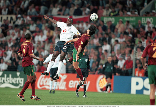 EMILE HESKEY outjumps Fernando Couto, ENGLAND 2 v Portugal 3, EURO 2000, Eindhoven, 000612. Photo: Glyn Kirk/Action Plus...2000.European Championships.Group A.football.soccer.header headers.international.internationals.association
