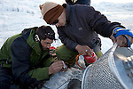 Dr Shresth Tayal (right), Glaciologist at The Energy and Resources Institute (TERI) with assistant Mohammad Ashraf Genai attempt to light a butane burner - part of the equipment used on the fast reducing Rathong Glacier  below the 6678 meter Rathong Peak  in the North East Indian state of Sikkim close to the Nepalese border. Considered to be a themometre of the environment, it has been chosen by TERI to be a test case of environmental damage being done in India and China. Dr. Tayal is conducting three dimensional tests that include measuring the depth of the ice to form concrete conclusions on the fate of the glacier.The Indian Government is denying the glaciers' demise despite data suggesting it has been reduced by more than over 80% in the last 42 years.