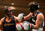 February 3, 2012:   Nevada boxer Anthony Donohue, right, fights against Cal boxer Jose Jiminez in the 165 pound weight class at the Eldorado Convention Center on Friday night in Reno, Nevada.  Jiminez won the fight when the referee stopped the contest in the third round.