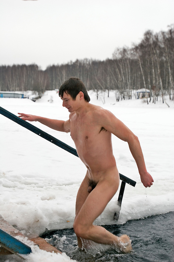 "Moscow, Russia, 31/12/2005..Russians celebrate the lengthy New Year and Orthodox Christmas holidays. Members of the Moscow Winter Swimmers Club, known colloquially by Russians as ""Walruses"", mark New Year with a swim in a frozen Moscow lake."
